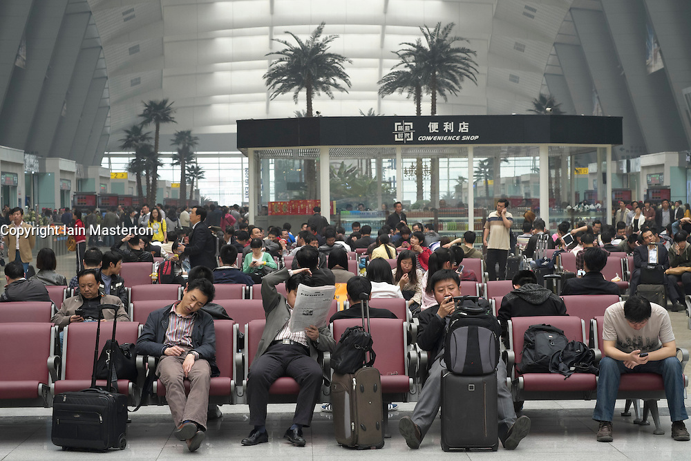 Passsengers waiting in new modern Beijing South Railway Station in China