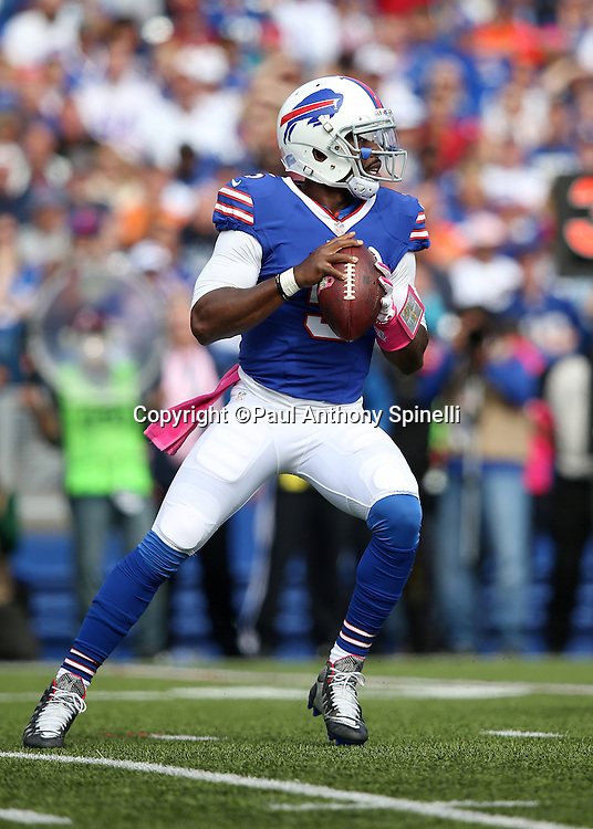 Buffalo Bills quarterback Tyrod Taylor (5) drop back to pass during the 2015 NFL week 4 regular season football game against the New York Giants on Sunday, Oct. 4, 2015 in Orchard Park, N.Y. The Giants won the game 24-10. (©Paul Anthony Spinelli)