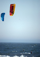 Two Kite Surfers enjoy unusually warm weather at Gilgo Beach New York , Saturday, January 06, 2006 (Andrew Gombert for The New York Times)<br />