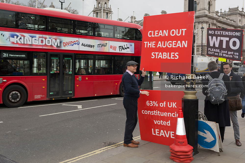 A day after Commons Speaker John Bercow announced his refusal to accept Prime Minster Theresa May's third Brexit Meaningful Vote, a Brexiteer holds a sign that refers to the stables in which the mythical Argonaut King Augeas kept 3000 oxen, and which had not been cleaned for 30 years. The cleaning of these stables was accomplished by Hercules, on 19th March 2019, in London, England.