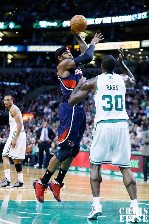 29 March 2013: Atlanta Hawks small forward Josh Smith (5) goes for the skyhook over Boston Celtics power forward Brandon Bass (30) during the Boston Celtics 118-107 victory over the Atlanta Hawks at the TD Garden, Boston, Massachusetts, USA.