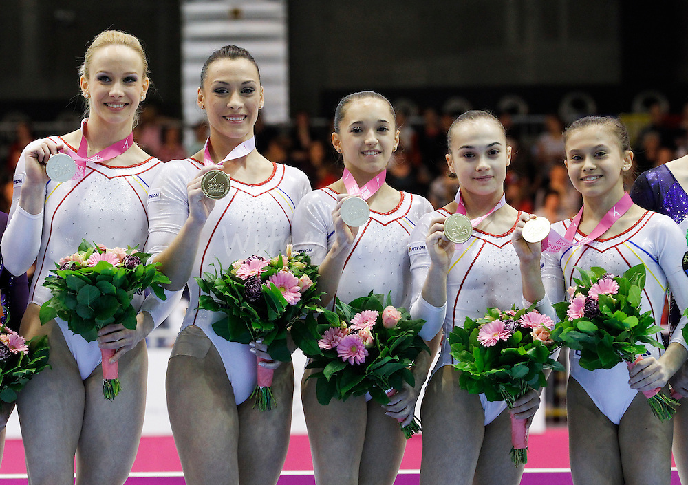 (L-R) Romanian team, Sandra Raluca Izbasa, Catalina Ponor, Diana Laura Bulimar, Raluca Oana Haidu, and Diana Laura Bulimar celebrates their gold medal during the seniors team final at the Women Artistic Gymnastics European Championships in Brussels, Belgium, 12 April 2012. Romanania won the team final ahead of Russia, second and Italy who took the third place.  French Youna Dufournet
