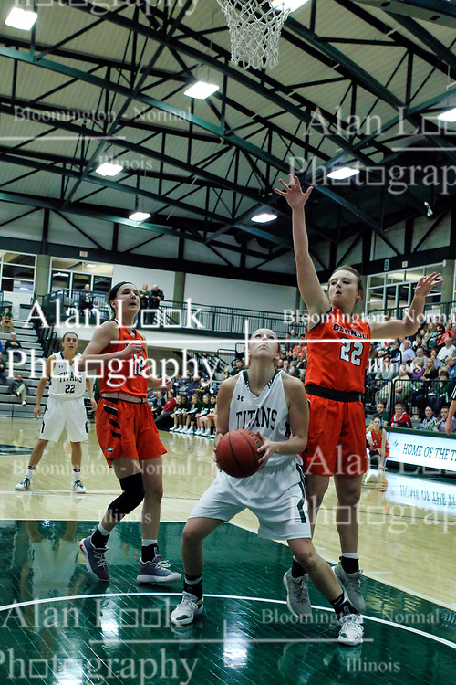 BLOOMINGTON, IL - December 15:  Celina Schwantes, Ashley Schneider and Sierra Gruborduring a college women's basketball game between the IWU Titans  and the Carroll Pioneers on December 15 2018 at Shirk Center in Bloomington, IL. (Photo by Alan Look)
