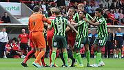 Tempers boil over between both sets of players during the Sky Bet League 2 match between Crawley Town and AFC Wimbledon at the Checkatrade.com Stadium, Crawley, England on 15 August 2015. Photo by Michael Hulf.
