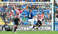 CARDIFF, WALES - Sunday, August 8, 2010: Sheffield United's Ched Evans celebrates scoring the opening goal against Cardiff City during the League Championship match at the Cardiff City Stadium. (Pic by: David Rawcliffe/Propaganda)