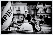 "Henley on Thames,  GREAT BRITAIN, 4 July 2008, Henley Umpire and Steward, Fred SMALLBONE, ""Explaining the Winning Margin"" to his Guest's, on board, ""ULYSSES"", after an evening race,  2008 Henley Royal Regatta, on  Friday, Henley on Thames. ENGLAND.,  ""Film Noir Style Photography"", © Peter SPURRIER,"