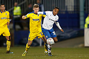 Max Sanders of Wimbledon  and Neil Danns of Tranmere Rovers  contest a loose ball  during the EFL Sky Bet League 1 match between Tranmere Rovers and AFC Wimbledon at Prenton Park, Birkenhead, England on 21 December 2019.