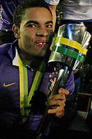 20090701: PORTO ALEGRE, BRAZIL - Internacional vs Corinthians: Brazilian Cup 2009 - Final - 2nd Leg. In picture: Dentinho (Corinthians) celebrating with the trophy. PHOTO: CITYFILES