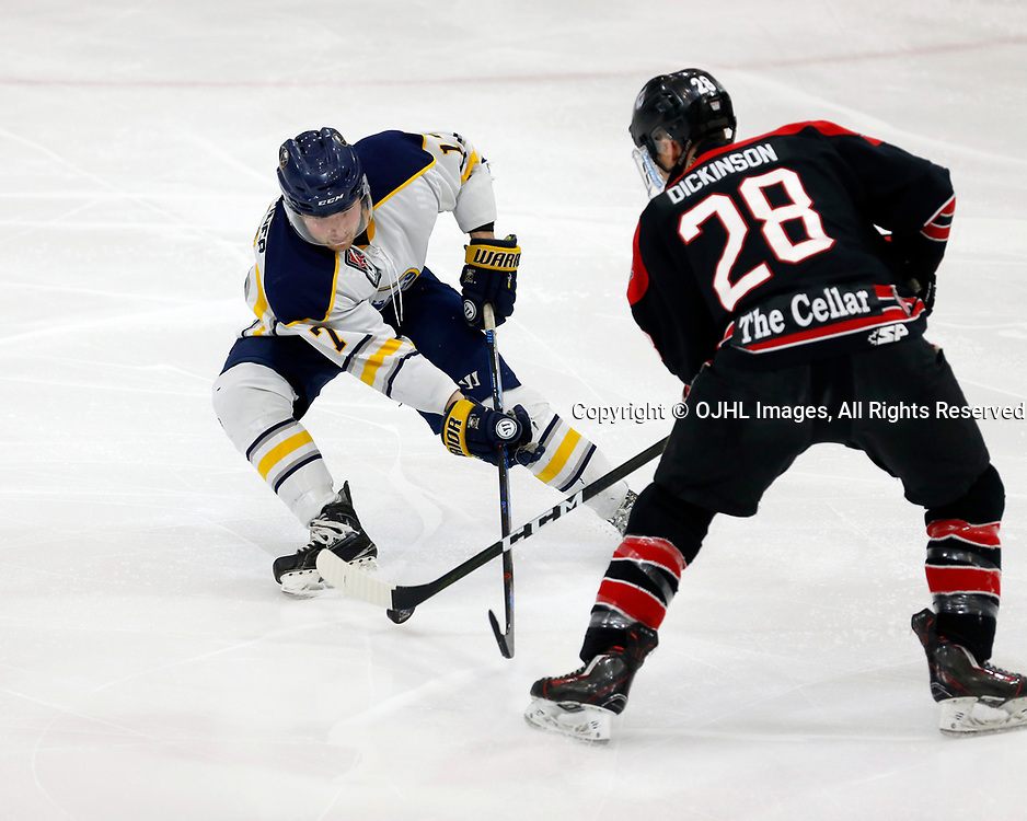 Buffalo, NY - MAR 9,  2017: Ontario Junior Hockey League game between Buffalo and Georgetown, Buffalo Jr. Sabres defenseman Matthew Buchbinder (17) and Georgetown Raiders forward Josh Dickinson (28) go after a loose puck during the first period. (Photo by Timothy T. Ludwig / OJHL Images)