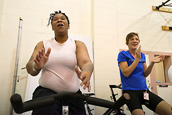 Leahya Ellis and Kristin Gavin (right), director and founder of Gearing-Up, participate in an intensive ten-count exercise