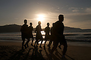 Mexican Army squad runs the Rincon de Guayabitos beach each afternoon. Approximately six miles of soft and hard sand. Rincon de Guayabitos is a popular tourist destination 40 miles north of Puerto Vallarta.