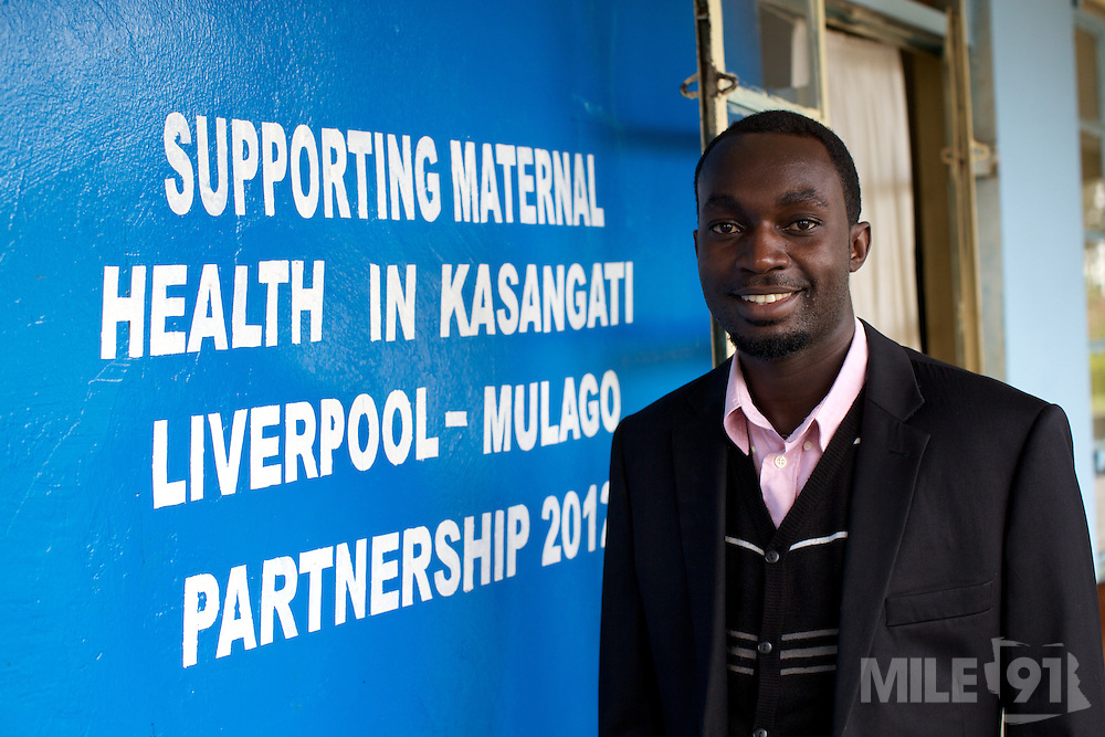 Doctor Ivan Nyenje checks outside Kasangati Health Centre in Uganda.