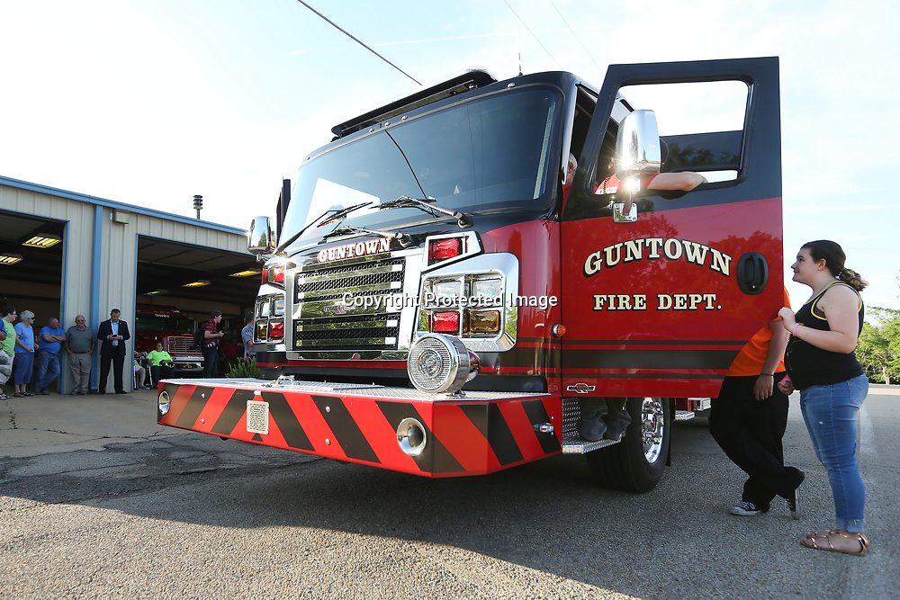 Members of the Guntown Volunteer Fire Department, the public, local and city officials, get the first look of the departments new Fireturck that arrived at the station on Wednesday night.
