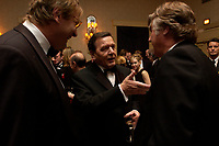 """20 NOV 2003, NEW YORK/USA:<br /> Gerhard Schroeder, SPD, Bundeskanzler, im Gespraech mit Spitzenvertretern der Wirtschaft, waehrend einem Empfang vor einer Festveranstaltung des American Institute for Contemporary German Studies anl. der Verleihung des """"Global Leadership Awards"""" Hotel Grand Hyatt at Grand Central<br /> IMAGE: 20031120-03-019<br /> KEYWORDS: Gerhard Schröder, U.S.A., Reise, Smoking<br /> Gespräch"""