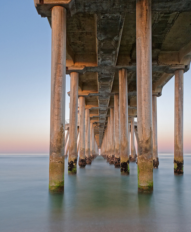 Photo was taken under the Huntington Beach Pier at sunrise on a beautiful morning in May.