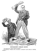 "Socialism's Great Asset. Lord Rothermere. ""Down with Baldwin!"" Mr MacDonald. ""Thank you so much; I couldn't have done it better myself!"" (an InterWar cartoon showing Lord Rothermere holding his Daily Mail newspaper and standing on the Rothermere Press while Ramsay MacDonald salutes him)"