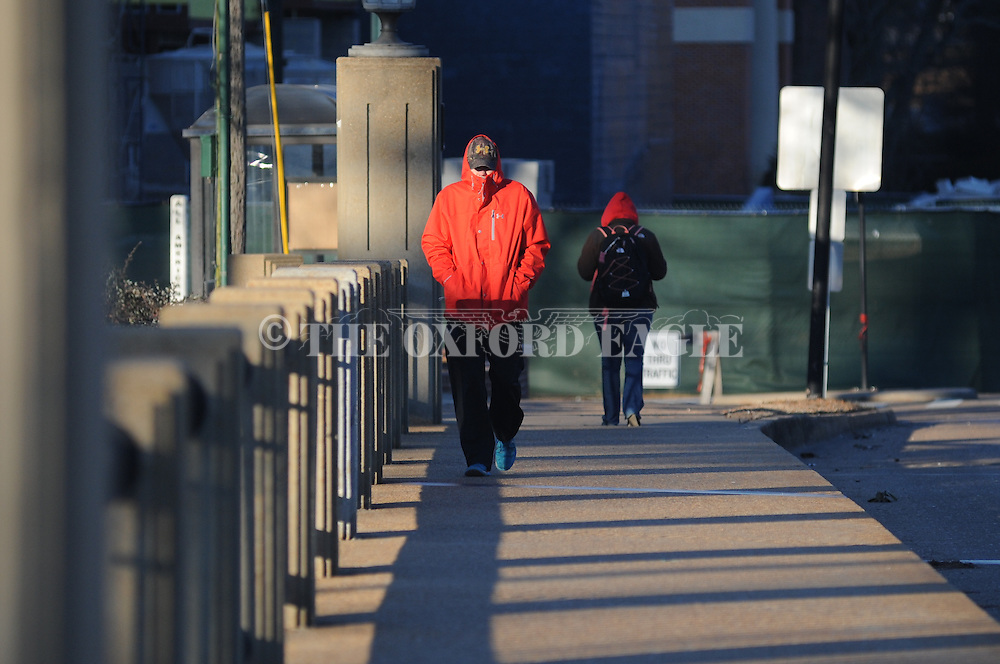 John Jenks is bundled up for cold weather as he walks along University Avenue in Oxford, Miss. on Thursday, January 8, 2015.
