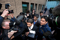 © Licensed to London News Pictures. 02/11/2011. LONDON, UK. Pakistani cricketer, Salman Butt (wearing a suit and blue shirt), pushes through a media scrum as he arrives at Southwark Magistrates in London to be sentenced for match fixing. Photo credit: Matt Cetti-Roberts/LNP