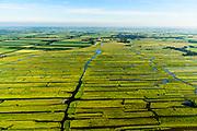 Nederland, Noord-Holland, Gemeente Schermer, 13-06-2017; Grootschermer met de Eilandspolder. Kenmerkend voor polder is de onregelmatige verkaveling en deze staat in contrast met de beroemde geometrische verkaveling van de Beemster in de achtergrond. De Eilandspolder is een vaarland of vaarpolder (landerijen niet bereikbaar via de weg). Natura 2000 laagveen natuurgebied. The polder Eilandspolder in the foreground has an irregular land division.<br /> luchtfoto (toeslag op standard tarieven);<br /> aerial photo (additional fee required);<br /> copyright foto/photo Siebe Swart