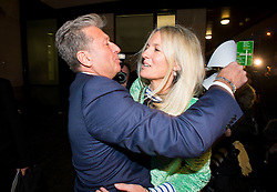 © Licensed to London News Pictures. 14/12/2015. London, UK. Radio DJ NEIL FOX, aka Dr Fox, hugs andkissing his wife VICKY FOX as he leaves Westminster Magistrates Court in London, where he was found not guilty on 10 separate charges of indecent assault and sexual assault. Photo credit: Ben Cawthra/LNP