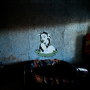 March 27, 2012 - Dublin, Ireland: A painting of Marilyne Monroe is seen in the wall of a room at the Billion Euro House art installation by the Irish artist Frank Buckley. ..Worthless euros, taken out of circulation and shredded by Irelands Central Bank, formes the interior walls of an apartment that Mr. Buckley does not own in a building left vacant by the countrys economic ruin...The artist decided to call the apartment  built from thousands of bricks of shredded, decommissioned cash (each brick contains, roughly, what used to be 50,000 euros)  the Billion Euro House. He reckons that about 1.4 billion euros actually went into it, but the joke, of course, is that it is worth simultaneously so much and so little...A large gravestone beside the main door, announces that Irish sovereignty died in 2010, the year that the government accepted an international bailout so larded with onerous conditions that the Irish will be paying for it for years to come. (Paulo Nunes dos Santos/Polaris)