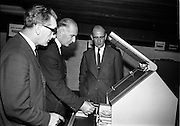 "19/09/1967<br /> 09/19/1967<br /> 19 September 1967<br /> Opening of Agfa-Gevaert exhibition at the Building Centre, Lower Baggot Street, Dublin. Exhibition ""Microfilms in the Space Age"" demonstrating microfilming equipment and facilities, most of the equipment was exclusive to Agfa-Gevaert Limited. Pictured (l-r) are: Mr G.L. Latchtard, Kevin Street College of Technology;  Mr Hugh de Lacey, Kevin Street College of Technology and Mr Patrick Howard,General Manager, Agfa-Gevaert Ltd., viewing some of the equipment."