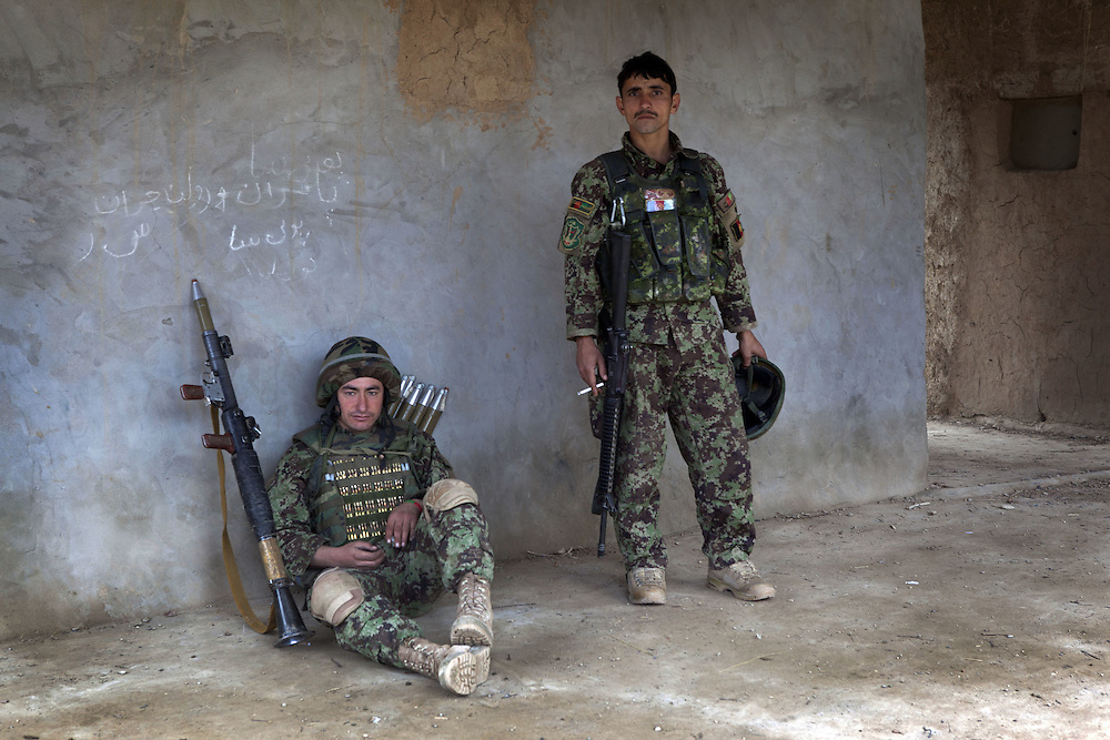 ANA (Afghan Nation Army) soldiers assist in providing security for a counter IED shura in Nad Ali, Hemand Province, Afghanistan on the 10th of March 2011.