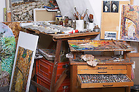 Paints and Canvases in Artist's Studio