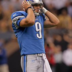 2009 September 13: Detroit Lions rookie quarterback Matthew Stafford (9) gets a call from the sideline during a 45-27 win by the New Orleans Saints over the Detroit Lions at the Louisiana Superdome in New Orleans, Louisiana.