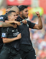 Philippe Coutinho of Liverpool celebrates with his team mates after scoring - Mandatory byline: Dougie Allward/JMP - 07966386802 - 09/08/2015 - FOOTBALL - Britannia Stadium -Stoke-On-Trent,England - Stoke City v Liverpool - Barclays Premier League