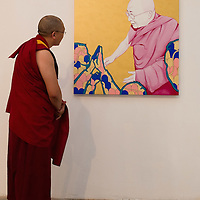 "VENICE, ITALY - JUNE 04:  A Tibetan Monk looks at ""Free Tibet "" a painting by Piergiorgio Baroldi at ""The Pavillion Tibet"" a project by Ruggero Maggi on June 4, 2011 in Venice, Italy. The Venice Art Biennale will run from June 4 to November 27, 2011."