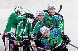 Tomi Mustonen, Anze Ropret, Bostjan Golicic and Ziga Pavlin of Olimpija celebrate after 1st goal during ice-hockey match between HDD Tilia Olimpija and HK Acroni Jesenice in 26th Round of EBEL league, on December 10, 2010 at Hala Tivoli, Ljubljana, Slovenia.(Photo By Vid Ponikvar / Sportida.com)