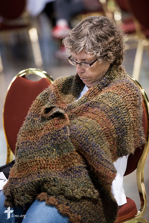 An attendee stays warm on Wednesday, July 13, 2016, at the 66th Regular Convention of The Lutheran Church–Missouri Synod, in Milwaukee. LCMS/Michael Schuermann