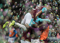 Football - 2017 / 2018 Premier League - West Ham United Vs Huddersfield Town<br /> <br /> Pedro Obiang (West Ham United)  and Michail Antonio (West Ham United) and Aaron Cresswell (West Ham United)  celebrate amongst the bubbles at the London Stadium<br /> <br /> COLORSPORT/DANIEL BEARHAM