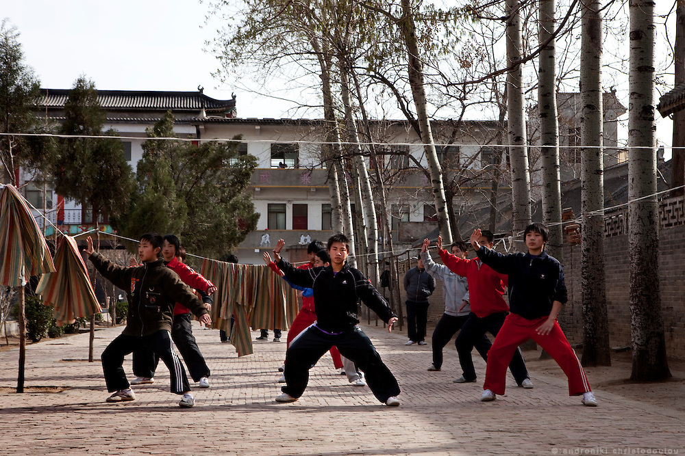 Students trainning outdoors at  the Taijiquan school in Chenjiagou village. Most students of the school live at the dormitories and rooms of the school untill they complete their studies.