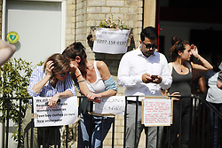 © Licensed to London News Pictures. 14/06/2017. London, UK. Volunteers bring supplies to a nearby church as the Grenfell Tower fire is still not under control 14 hours after the fire broke in west London on 14 June 2017. Photo credit: Tolga Akmen/LNP