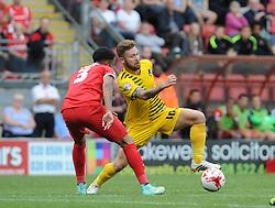 Matt Taylor of Bristol Rovers is challenged by Frazer Shaw of Leyton Orient - Mandatory byline: Neil Brookman/JMP - 07966386802 - 29/08/2015 - FOOTBALL - Matchroom Stadium -Leyton,England - Leyton Orient v Bristol Rovers - Sky Bet League Two