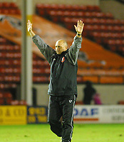 Photo: Dave Linney.<br />Walsall v Notts County. Coca Cola League 2. 25/11/2006.<br />Walsall Mgr Richard Money salutes the fans at the end of the game.