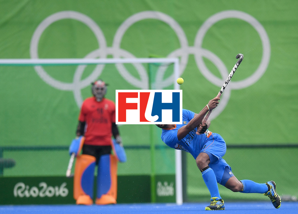 India's Rupinder Pal Singh hits the ball during the men's field hockey Germany vs India match of the Rio 2016 Olympics Games at the Olympic Hockey Centre in Rio de Janeiro on August, 8 2016. / AFP / MANAN VATSYAYANA        (Photo credit should read MANAN VATSYAYANA/AFP/Getty Images)