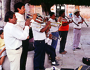Men in a brass band musicians playing outside, San Miguel de Allende, Mexico