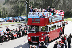 Winter Olympic Gold medalist Lizzy Yarnold (in bus left) is greeted by flag waving pupils as she returns to her former school, St.Michael's Preparatory School in Otford, Kent ,United Kingdom, during an open top bus parade through the county,  Friday, 21st March 2014. Picture by Stephen Lock / i-Images