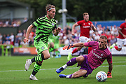 Forest Green Rovers George Williams(11) rounds Bristol City goalkeeper Dan Bentley during the Pre-Season Friendly match between Forest Green Rovers and Bristol City at the New Lawn, Forest Green, United Kingdom on 24 July 2019.