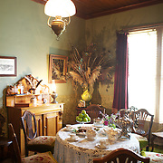 The dining room at The Katherine Mansfield Birthplace, Wellington. The Katherine Mansfield Birthplace is the childhood home of one of the world's best-known short story writers and New Zealand's most famous author..You can enjoy a virtual visit to this historic family home and garden, as well as discover the life and work of the writer herself at The Katherine Mansfield Birthplace. Tinakori Road. Thorndon. Wellington, New Zealand.  22nd January 2011. Photo Tim Clayton.