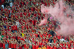 LYON, FRANCE - Wednesday, July 6, 2016: Wales supporters let off a red smoke bomb after the UEFA Euro 2016 Championship Semi-Final match against Portugal at the Stade de Lyon. (Pic by Paul Greenwood/Propaganda)