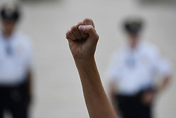 October 6, 2018 - Washington, DC, United States - The fist of Carolin Harding, of Columbus, OH, goes up in protest as people gather at the US Supreme Court to protest the expected nomination of Judge Brett Kavanaugh, in Washington, D.C., on October 6, 2018. (Credit Image: © Bastiaan Slabbers/NurPhoto/ZUMA Press)