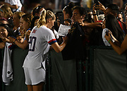 United States midfielder Allie Long (20) signs autographs after an international friendly women's soccer match, Saturday, Aug. 3, 2019,  in Pasadena, Calif., The U.S. defeated Ireland 3-0. (Dylan Stewart/Image of Sport)