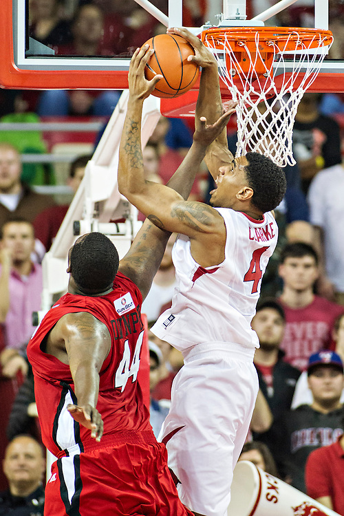 FAYETTEVILLE, AR - NOVEMBER 15:  Coty Clarke #4 of the Arkansas Razorbacks goes up for a rebound over J.J. Davenport #44 of the Louisiana Ragin' Cajuns at Bud Walton Arena on November 15, 2013 in Fayetteville, Arkansas.  The Razorbacks defeated the Ragin' Cajuns 76-63.  (Photo by Wesley Hitt/Getty Images) *** Local Caption *** Coty Clarke; J.J. Davenport