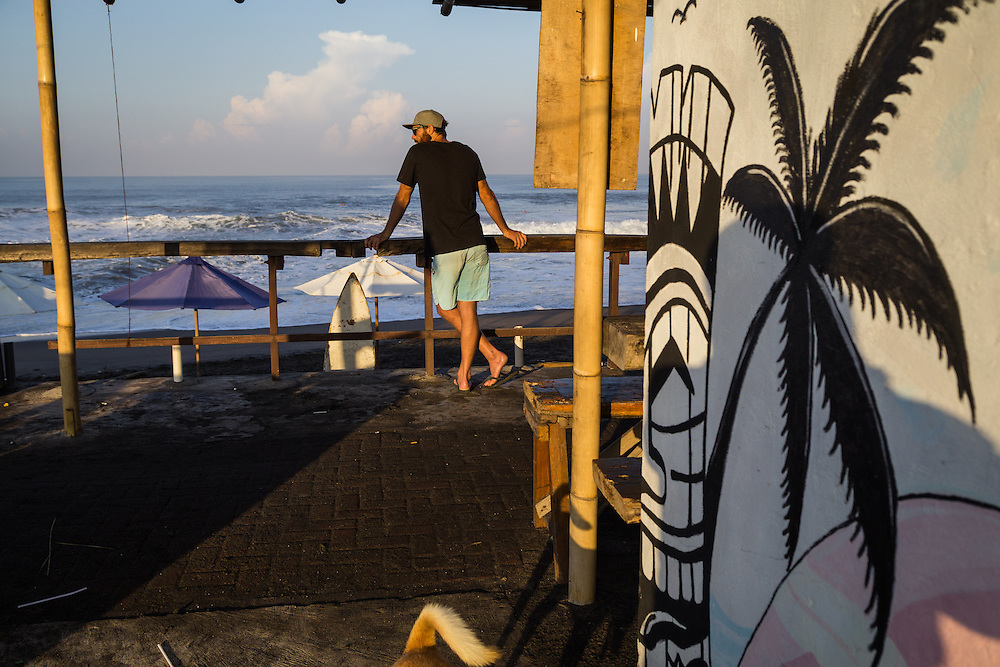 A man looks toward the horizon at Echo beach, Canggu.