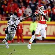 KANSAS CITY SPORTS PHOTOGRAPHER- Kansas City Chiefs wide receiver Demarcus Robinson (11) catches an 89-yard Patrick Mahomes pass for a touchdown as Oakland Raiders cornerback Rashaan Melvin (22) defends during the third quarter of an NFL football game in Kansas City, Mo., Sunday, Dec. 30, 2018.   (AP Photo/Colin E. Braley)