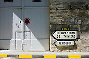 Signpost in town of Bourdeilles popular tourist destination near Brantome in Northern Dordogne, France